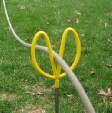 Yardstick Holding a Carpet Cleaning Solution Hose
